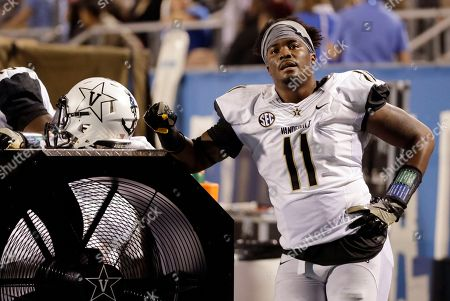 Vanderbilt linebacker Charles Wright takes a break in the second half of an NCAA college football game against Middle Tennessee, in Murfreesboro, Tenn