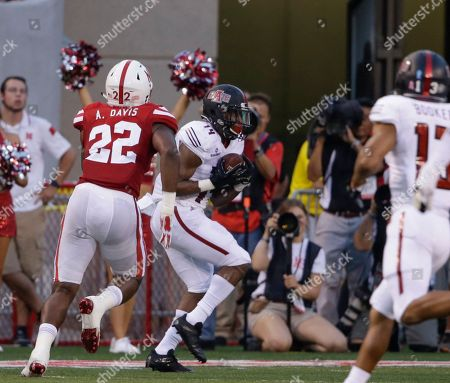 Alex Davis, Chris Murray Arkansas State wide receiver Chris Murray (14) makes a touchdown catch in front of Nebraska linebacker Alex Davis (22) during the first half of an NCAA college football game in Lincoln, Neb