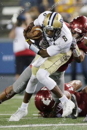 Stock Picture of Chris Murray, Logan Tago Montana State quarterback Chris Murray (8) is brought down by Washington State defensive lineman Logan Tago during the first half of an NCAA college football game in Pullman, Wash