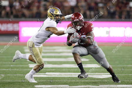 Stock Picture of Gerard Wicks, Damien Washington Washington State running back Gerard Wicks (23) runs with the ball while defended by Montana State cornerback Damien Washington during the first half of an NCAA college football game in Pullman, Wash