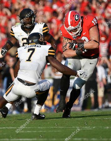 Isaac Nauta, Josh Thomas Georgia tight end Isaac Nauta (18) runs as Appalachian State defensive back Josh Thomas (7) defends during an NCAA college football game, in Athens, Ga. Georgia won 31-10
