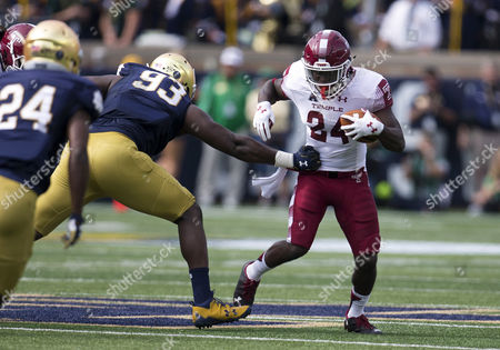 Temple running back Tyliek Raynor (34) runs with the ball as Notre Dame defensive lineman Jay Hayes (93) defends during NCAA football game action between the Temple Owls and the Notre Dame Fighting Irish at Notre Dame Stadium in South Bend, Indiana. Notre Dame defeated Temple 49-16