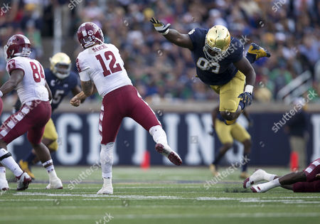 Temple quarterback Logan Marchi (12) passes the ball as Notre Dame defensive lineman Jay Hayes (93) rushes during NCAA football game action between the Temple Owls and the Notre Dame Fighting Irish at Notre Dame Stadium in South Bend, Indiana. Notre Dame defeated Temple 49-16