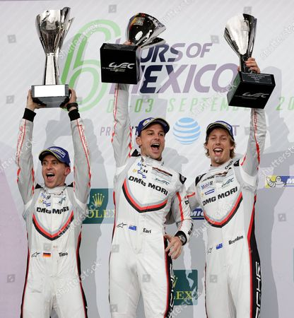 German Timo Bernhard (L) and New Zealanders Brendon Hartley (R) and Earl Bamber (C) of the Team Porsche LMP of the LMP1 category celebrate after winning the first place in the '6 hours of Mexico' FIA World Endurance Championship at Autodromo Hermanos Rodriguez in Mexico City, Mexico, 03 September 2017. The '6 Hours of Mexico' is one of nine season stages of the FIA World Endurance Championship.