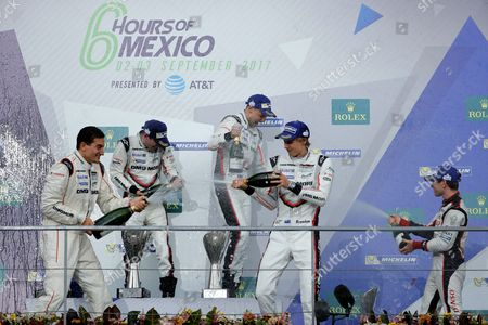 (L-R, front row) German Timo Bernhard and New Zealanders Brendon Hartley and Earl Bamber of the Team Porsche LMP of the LMP1 category celebrate after winning the first place in the '6 hours of Mexico' FIA World Endurance Championship at Autodromo Hermanos Rodriguez in Mexico City, Mexico, 03 September 2017. The '6 Hours of Mexico' is one of nine season stages of the FIA World Endurance Championship.