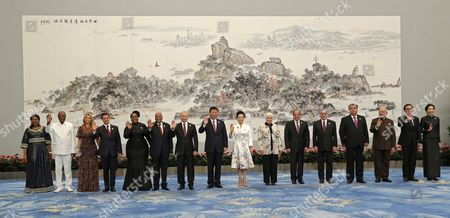 Stock Photo of (L-R) Guinea's First Lady Djene Kaba Conde and Guinea's President Alpha Conde, Mexican First Lady Angélica Rivera and Mexican President Enrique Pena Nieto, South African First Lady Thobeka Madiba-Zuma and South African President Jacob Zuma, Russian President Vladimir Putin, Chinese President Xi Jinping and his wife Peng Liyuan, Egyptian First Lady Entissar Amer and Egyptian President Abdel Fattah al-Sisi, Brazil's President Michel Temer, Tajikistan President Emomali Rakhmon, Indian Prime Minister Narendra Modi, Thai Premier Prayuth Chan-O-cha and his wife Naraporn Chan-O-cha, pose for a family photo ahead the banquet of the BRICS Summit at the Xiamen International Conference and Exhibition Center in Xiamen, southeastern China's Fujian Province, 04 September 2017. The ninth BRICS (Brazil, Russia, India, China and South Africa) Summit in Xiamen runs from 03 to 05 September.
