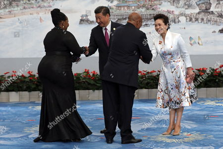 Chinese President Xi Jinping (2-L) and his wife Peng Liyuan (R), shake hands with South African First Lady Thobeka Madiba-Zuma (L) and South African President Jacob Zuma (2-R) ahead the banquet of the BRICS Summit at the Xiamen International Conference and Exhibition Center in Xiamen, southeastern China's Fujian Province, 04 September 2017. The ninth BRICS (Brazil, Russia, India, China and South Africa) Summit in Xiamen runs from 03 to 05 September.