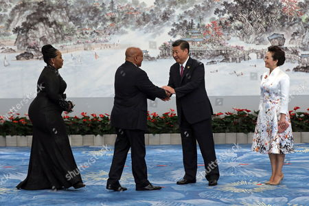 Stock Photo of Chinese President Xi Jinping (2-R) and his wife Peng Liyuan (R), shake hands with South African First Lady Thobeka Madiba-Zuma (L) and South African President Jacob Zuma (2-L) ahead the banquet of the BRICS Summit at the Xiamen International Conference and Exhibition Center in Xiamen, southeastern China's Fujian Province, 04 September 2017. The ninth BRICS (Brazil, Russia, India, China and South Africa) Summit in Xiamen runs from 03 to 05 September.