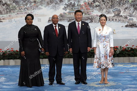 Stock Image of Chinese President Xi Jinping (2-R) and his wife Peng Liyuan (R), South African First Lady Thobeka Madiba-Zuma (L) and South African President Jacob Zuma (2-L) pose for photo ahead the banquet of the BRICS Summit at the Xiamen International Conference and Exhibition Center in Xiamen, southeastern China's Fujian Province, 04 September 2017. The ninth BRICS (Brazil, Russia, India, China and South Africa) Summit in Xiamen runs from 03 to 05 September.