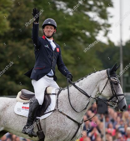 Oliver Townend celebrates in the arena after winning the Land Rover Burghley Horse Trials 2017, This is the first British winner since William Fox-Pitt six years ago.