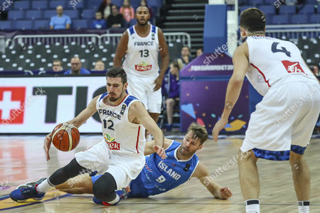 Iceland's Jon Arnor Stefansson (2-R) in action against France's Nando De Colo (L), Boris Diaw (2-L) and Thomas Heurtel during the EuroBasket 2017 group A match between France and Iceland in Helsinki, Finland, 03 September 2017.