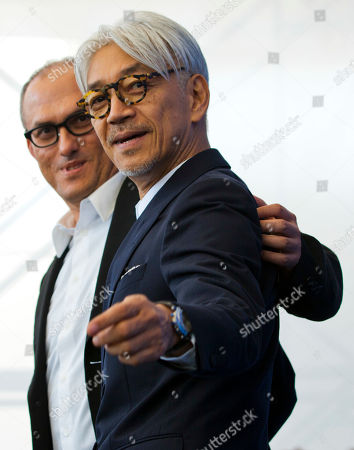 "Ryuichi Sakamoto, Stephen Nomura Schible Maestro Ryuichi Sakamoto, right, poses with director Stephen Nomura Schible during a photo call for the film ""Coda"" at the 74th Venice Film Festival in Venice, Italy"