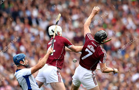 Galway vs Waterford. Galway's John Hansbury and Aidan Harte with Michael Walsh of Waterford