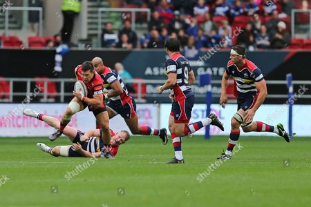 Stock Image of Hartpury centre Steve Leonard (13) riding the tackles during the Green King IPA Championship match between Bristol Rugby and Hartpury at Ashton Gate, Bristol