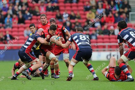 Stock Picture of Hartpury centre Steve Leonard (13) tries to run through the tackles during the Green King IPA Championship match between Bristol Rugby and Hartpury at Ashton Gate, Bristol