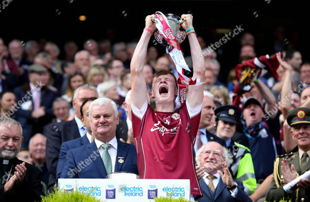 Cork vs Galway. Galway's Darren Morrissey lifts the trophy