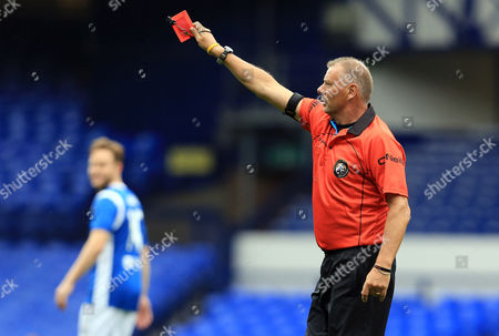 Referee Mr Mark Halsey holds up a red card
