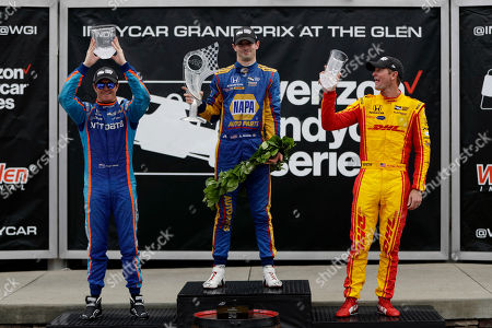 Alexander Rossi, Ryan Hunter-Reay, Scott Dixon Winner Alexander Rossi, center, reacts after his wreath fell while posing with second-place finisher, Scott Dixon, left, and third-place finisher, Ryan Hunter-Reay after the IndyCar Series auto race, in Watkins Glen, N.Y