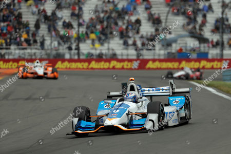 Scott Dixon drives into Turn 11 during the IndyCar Series auto race, in Watkins Glen, N.Y