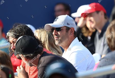 Former French tennis player Cedric Pioline is watching French tennis player Lucas Pouille in action during his match in the 4th round