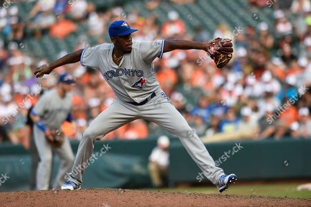 Toronto Blue Jays pitcher Carlos Ramirez throws against the Baltimore Orioles in a baseball game, in Baltimore