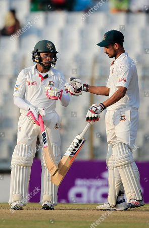 Bangladesh's captain Mushfiqur Rahim, left, and teammate Nasir Hossain celebrate a boundary during the first day of their second test cricket match against Australia in Chittagong, Bangladesh