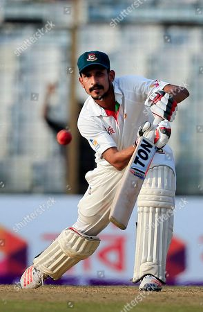 Bangladesh's Nasir Hossain plays a shot during the first day of the second test cricket match against Australia in Chittagong, Bangladesh