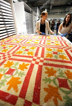 Megan Cook, Kathleen Barnett Graph, Mississippi Department of Archives and History assistant director of collections Megan Cook, left, and collections manager Kathleen Barnett spread out one of the quilts, shown at the Mississippi Department of Archives and History in Jackson, Miss. It will eventually be displayed in a special exhibit installed at the Museum of Mississippi History and the Mississippi Civil Rights Museum, which share a lobby and are being built in downtown Jackson