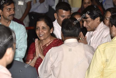 Nirmala Sitharaman after sworn-in as a Union Cabinet Minister by President Ram Nath Kovind and also seen in the picture union minister Suresh Prabhu at Rashtrapati Bhavan