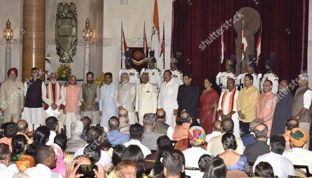 Stock Image of President Ram Nath Kovind, Vice President M. Venkaiah Naidu, Prime Minister Narendra Modi poses with new Ministers Hardeep Puri, R.K. Singh, Ashwini Choubey, Shiv Pratap Shukla, Mukhtar Abbas Naqavi, Dharmendra Pradhan, Piyush Goyal, Nirmala Sitharaman, Virendra Kumar, Anant Kumar Hegde, Satyapal Singh, K.J. Alphons, Gajendra Singh Shekhawat after the reshuffle at Rashtrapati Bhavan