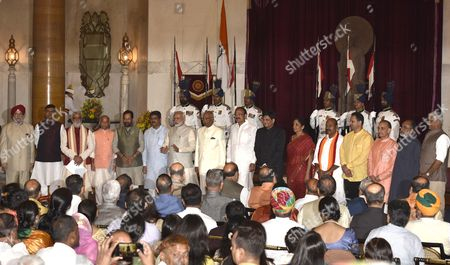 Stock Picture of President Ram Nath Kovind, Vice President M. Venkaiah Naidu, Prime Minister Narendra Modi poses with new Ministers Hardeep Puri, R.K. Singh, Ashwini Choubey, Shiv Pratap Shukla, Mukhtar Abbas Naqavi, Dharmendra Pradhan, Piyush Goyal, Nirmala Sitharaman, Virendra Kumar, Anant Kumar Hegde, Satyapal Singh, K.J. Alphons, Gajendra Singh Shekhawat after the reshuffle at Rashtrapati Bhavan