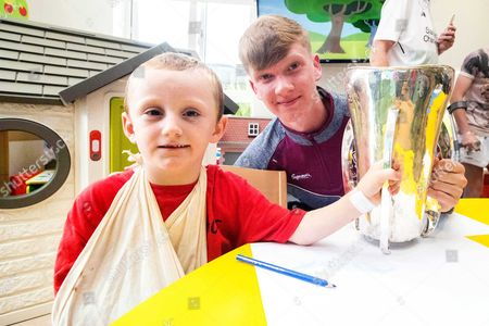 Martin Cummins, aged 5, from Kildare with minor captain Darren Morrissey