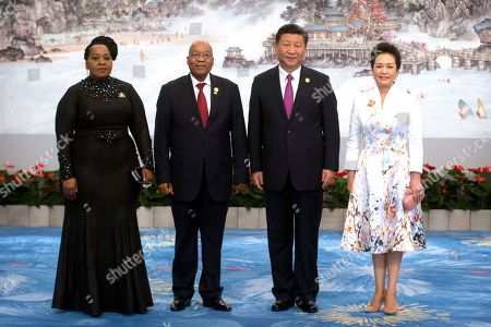 Xi Jinping, Peng Liyuan, Jacob Zuma, Thobeka Zuma South African President Jacob Zuma, second from left, Chinese President Xi Jinping, second from right, and their wives Thobeka Zuma, left, and Peng Liyuan, right, pose for a photo during the BRICS Summit in southeastern China's Fujian Province