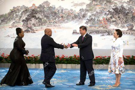 Stock Picture of Xi Jinping, Peng Liyuan, Jacob Zuma, Thobeka Zuma South African President Jacob Zuma, second from left, reaches to shake hands with Chinese President Xi Jinping as Zuma's wife Thobeka Zuma, left, and Xi's wife Peng Liyuan, right, watch during the BRICS Summit in southeastern China's Fujian Province