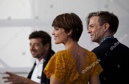"Micaela Ramazzotti, Patrick Bruel, Sebastiano Riso Actress Micaela Ramazzotti,center, poses with actor Patrick Bruel, left, and director Sebastiano Riso during the photo call of the film ""Una Famiglia"" (A Family) at the 74th Venice Film Festival in Venice, Italy"