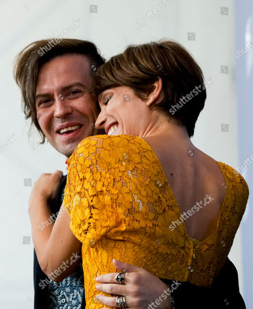 "Micaela Ramazzotti, Sebastiano Riso Actress Micaela Ramazzotti,right, poses with director Sebastiano Riso during the photo call of the film ""Una Famiglia"" (A Family) at the 74th Venice Film Festival in Venice, Italy"