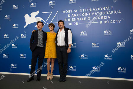 "Micaela Ramazzotti, Sebastiano Riso, Patrick Bruel Actress Micaela Ramazzotti,center, poses with director Sebastiano Riso, left, and actor Patrick Bruel during the photo call of the film ""Una Famiglia"" (A Family) at the 74th Venice Film Festival in Venice, Italy"