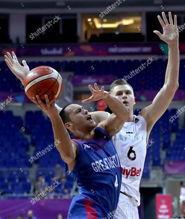 Stock Image of Britain's Andrew Lawrence (L) in action against Latvia's Kristaps Porzingis (R) during the EuroBasket 2017 group D match between Latvia and Britain, in Istanbul, Turkey, 04 September 2017.