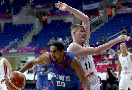 Latvia's Rolands Smits (back) in action against Britain's Kieron Achara (front) during the EuroBasket 2017 group D match between Latvia and Britain, in Istanbul, Turkey, 04 September 2017.