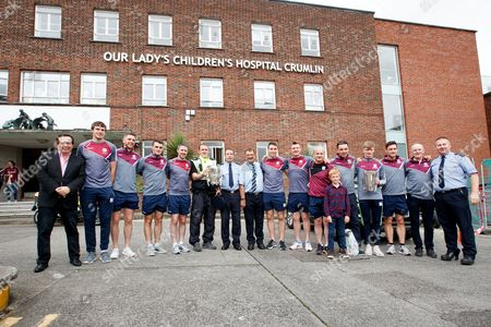 Members of the Galway minor and senior hurling team with RTE's Marty Morrissey outside Our Lady's Children's Hospital, Crumlin