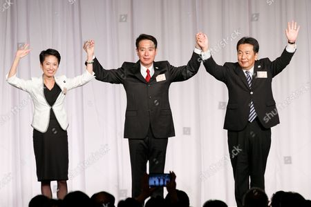 Stock Picture of (L to R) Japan's main opposition Democratic Party's former leader Renho Murata, new leader Seiji Maehara and Yukio Edano rise their hands during the party's plenary meeting