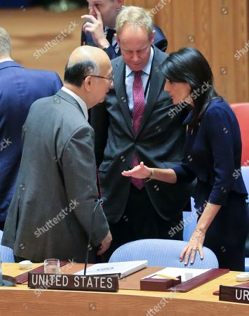 United Nations Ambassadors Koro Bessho of Japan, left, Matthew John Rycroft of the U.K., center, and Nikki Haley of the U.S. confer during U.N. Security Council's non-proliferation meeting on North Korea, at U.N. headquarters
