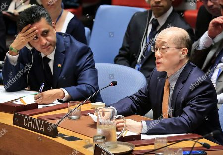 Bolivia's United Nations Ambassador Sacha Sergio Llorentty Solíz, left, listens as China's U.N. Ambassador Liu Jieyi addresses the U.N. Security Council's non-proliferation meeting on North Korea, at U.N. headquarters