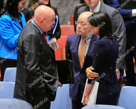 United Nations Ambassadors Vasily Nebenzya of Russia, left, Liu Jieyi of China, center, and Nikki Haley of the U.S., right, confer after the United Nations non-proliferation meeting on North Korea, at U.N. headquarters