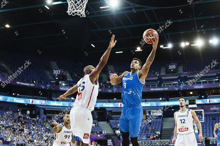 Boris Diaw (L) of France and Kristofer Acox of Iceland vie