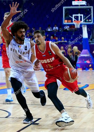 Russia's Aleksei Shved, right, tries to dribble past Belgium's captain Jonathan Tabu, left, during their Eurobasket European Basketball Championship Group D match in Istanbul