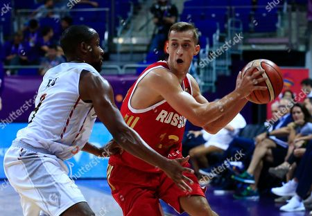 Russia's Dmitry Khvostov, right, tries to dribble past Belgium's captain Jonathan Tabu, left, during their Eurobasket European Basketball Championship Group D match in Istanbul