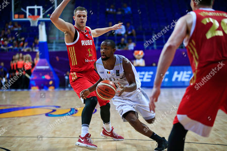 Belgium's captain Jonathan Tabu, left, dribbles the ball, during their Eurobasket European Basketball Championship Group D match against Russia in Istanbul, . Russia won the match 76-67