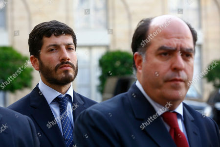 "President of the Venezuelan parliament, Julio Borges, right, and Venezuelan leading opposition activist, Roberto Patino, left, speak to the press after a meeting with France's President Emmanuel Macron, at the Elysee Palace, in Paris, . Macron, who recently called Venezuelan President Nicolas Maduro's leadership a ""dictatorship,"" denounced the move and said Saturday on Twitter: ""We are waiting for Lilian Tintori in Europe. The Venezuelan opposition must remain free"