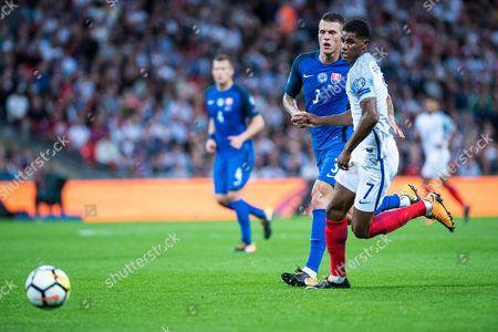 (7) Marcus RASHFORD, Slovakia (3) Martin SKRTEL during the FIFA World Cup Qualifier match between England and Slovakia at Wembley Stadium, London